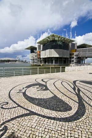 View of a modern aquarium building suspended on water located in Lisbon, Portugal.