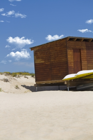 View of a typical wooden bar on a beautiful sandy beach. photo