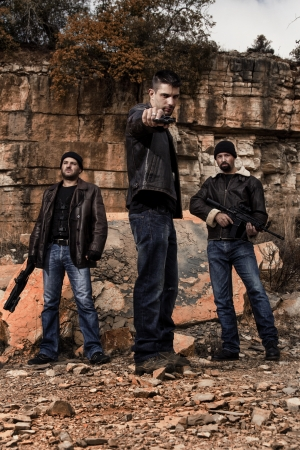 View of a group of gang members with guns. photo