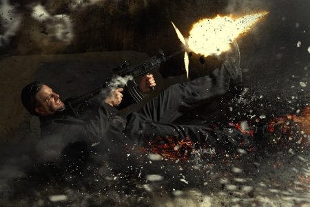 muzzle flash: View of a contracted type killer agent thrown in middle air from an explosion firing a machine gun.