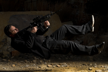View of a contracted type killer agent in middle air with a machine gun. photo