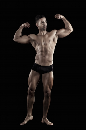 View of a muscled man on a black background in artistic, fitness and bodybuilding poses. Stock Photo - 17488406