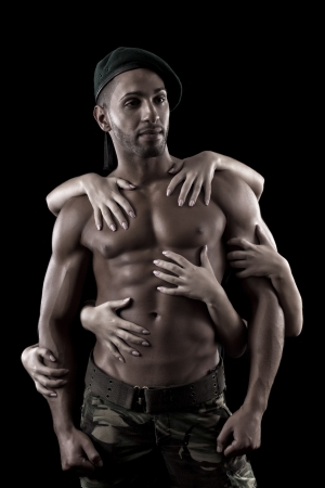 View of a muscled man on a black background in artistic, fitness and bodybuilding poses. photo