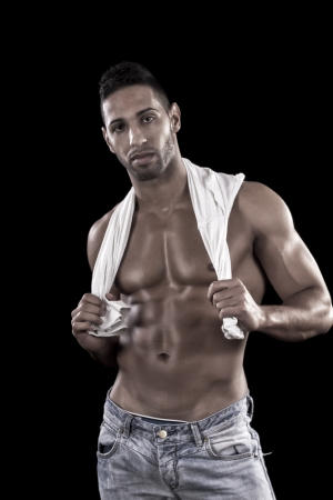 View of a muscled man on a black background in artistic, fitness and bodybuilding poses. Stock Photo - 17488895