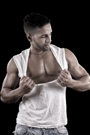 View of a muscled man on a black background in artistic, fitness and bodybuilding poses. Stock Photo - 17489113