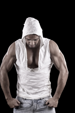 View of a muscled man on a black background in artistic, fitness and bodybuilding poses. Stock Photo - 17489012