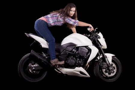 View of a beautiful young girl next to a white motorbike in a studio environment. Stock Photo - 17488559