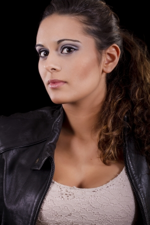 View of a beautiful young girl with a black leather jacket. Stock Photo - 17489284