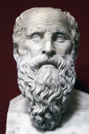 View of an ancient bust statue of philosopher Socrates located in the Vatican city.