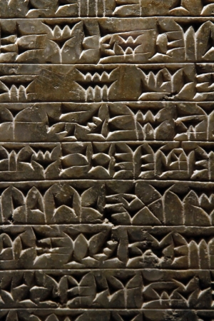 View of ancient Sumerian cuneiform writing engraved in a stone. photo