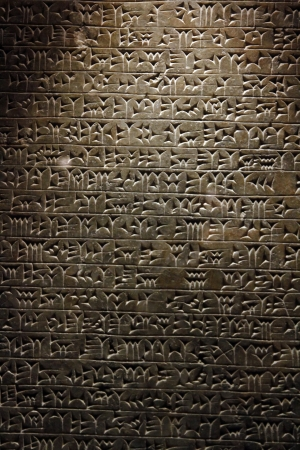 View of ancient Sumerian cuneiform writing engraved in a stone.