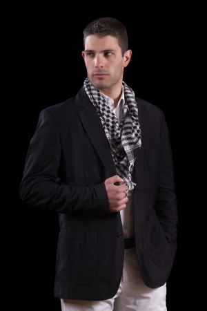 average guy: View of a young urban styled fashioned man standing isolated on a black background.