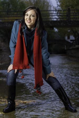 average: Young beautiful woman wearing winter clothing playful on a urban park.