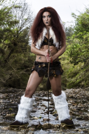 provocative woman: View of a beautiful young strong hunter warrior woman next to a river.