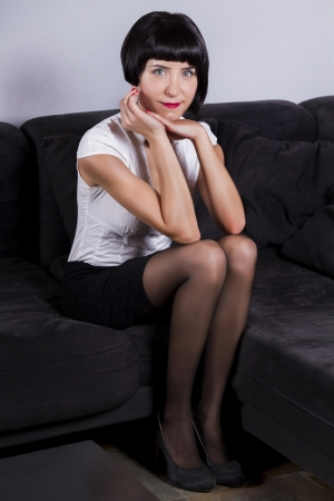 View of a modern pin-up girl in the sofa.  photo