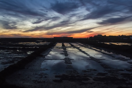 salt marsh: View of a industrial saline location in the sunset.