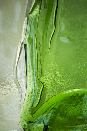 impure: Close up view of a deformation on green glass texture. Stock Photo