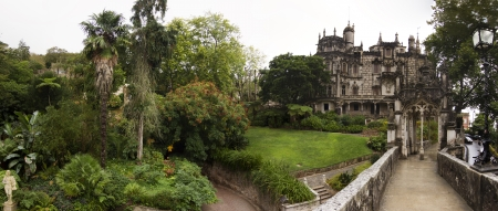 quinta: Panoramic view of the main beautiful building located in Quinta da Regaleira park, Sintra, Portugal.
