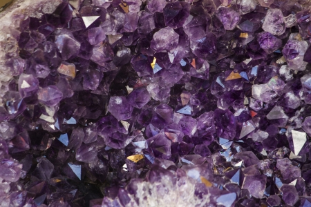 Close up view of a natural violet amethyst crystal geode stone.