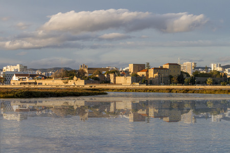 ria: Beautiful view of the city of Faro, Portugal, creating a reflection on the water. Stock Photo