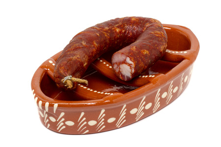 griller: Close up view of a traditional portuguese pottery for grilling chorizos.  Stock Photo