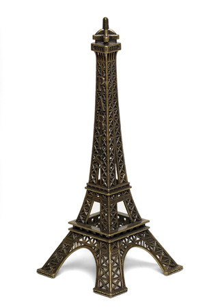 Close up view of a small Eiffel tower statue isolated on a white . photo