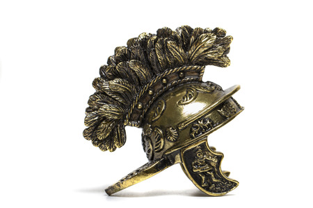 Close up view of small miniature roman helmet isolated on a white . Stock Photo - 26998573