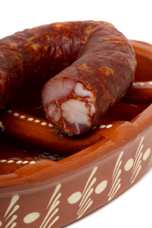 chorizos: Close up view of a traditional portuguese pottery for grilling chorizos.  Stock Photo