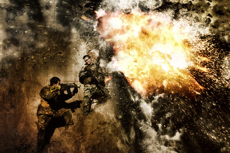 airsoft: Two airsoft group team members crouch in defense of a massive resulting explosion.