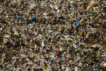 View of a massive trash dump site, result of the human activity. photo