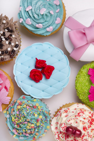 Close up view of original and creative cupcake designs isolated on a white background. photo