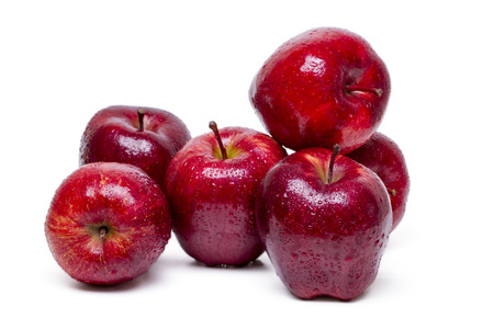Close up view of some red apples isolated on a white background.