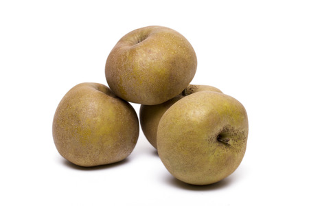 russet: Close up view of several brown apples isolated on a white background. Stock Photo