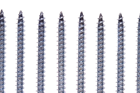 standard steel: Several aligned iron screws isolated on a white background.