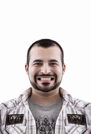 Close up view of a happy portrait of a young man with short hair and beard. Stock Photo