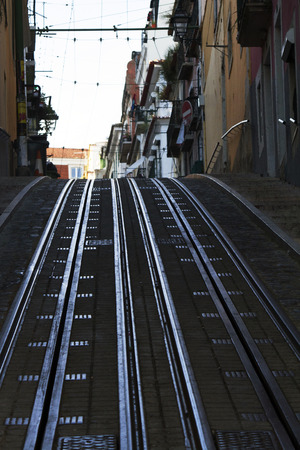 bica: View of the famous street of the Bica lift for the yellow electrical trams, located in Lisbon, Portugal. Editorial