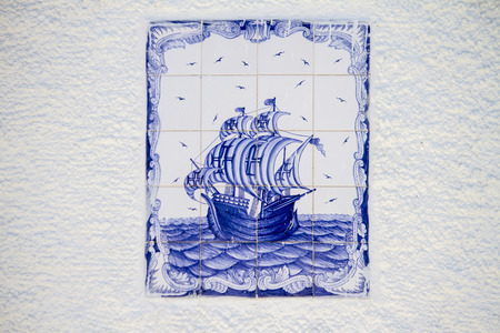 caravel: View of a beautiful decorated azulejo tile depicting a Portuguese caravel ship.