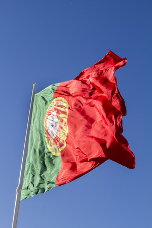 flapping: View of a huge portuguese flag flapping in the wind.