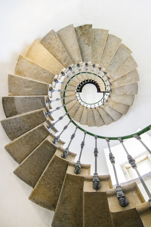 View Of An Amazing Spiral Staircase Inside A Lighthouse. Photo