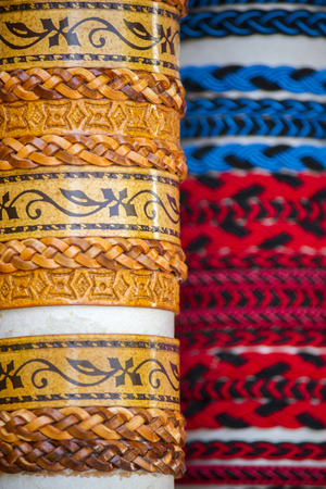 cuff bracelet: Close up view of many various leather and textile bracelets.