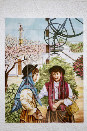 View of a beautiful decorated azulejo tile depicting the Portuguese rural culture.