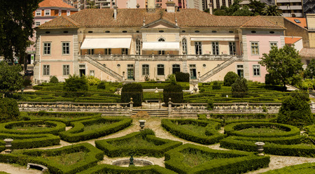 trimmed: View of a beautiful classical building with a wonderful trimmed bush garden located on the Lisbon zoo, Portugal.