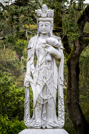 divinity: Close up view of a beautiful Buddha statue on a park. Stock Photo