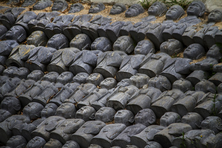 divinity: Close up view of a bunch of tiny Buddha statues. Stock Photo