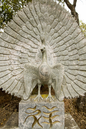 divinity: Close up view of a beautiful bird statue on a park.