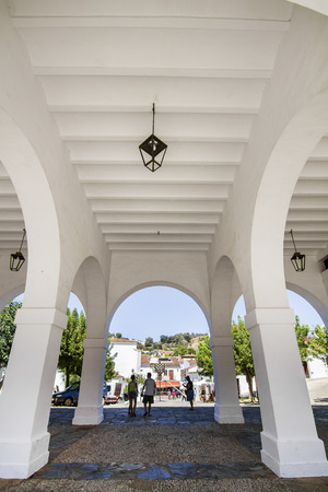arcs: View of beautiful arcs of a building located in Aracena, Spain.