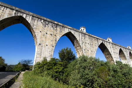 18th: View of the historical aqueduct built in the 18th century, located in Lisbon, Portugal. Stock Photo