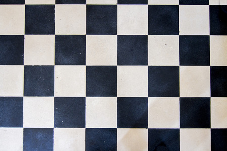 checker: Close up view of a black and white floor in a checker pattern.