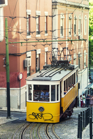 electric tram: View of the famous lift of vintage electric tram of Gloria, located in Lisbon, Portugal. Stock Photo