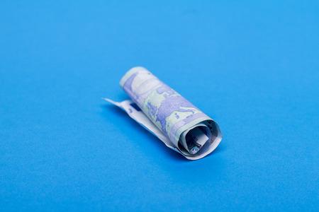 twenty: Twenty euros bill wrinkled into a roll. Stock Photo